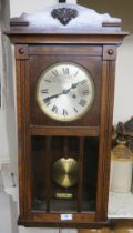 A stained wood wall clock with Roman numerals Condition Report: Available upon request