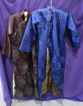 A blue ground fur-lined Chinese robe, and another aubergine ground example Condition Report: Not