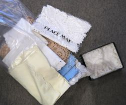 A lot comprising assorted table linen with lace and embroidered examples Condition Report: Not