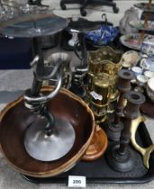 A lot comprising a pair of metal abstract candlesticks, another wooden pair, a wooden snuffbox