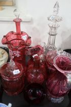 A selection of cranberry glass including a Mary Gregory style vase hand painted by S. Stephens,