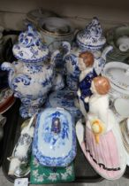 A lot comprising a pair of Delft blue and white urns, a Staffordshire figure of a couple, a Spode
