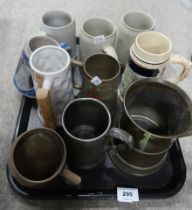 A lot comprising continental beer steins, two enamelled examples, a glass bottom tankard etc