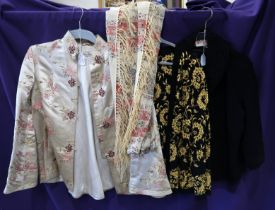A lot comprising a cream ground floral embroidered ladies jacket, two other embroidered examples,