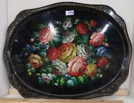 A Russian tole tray hand painted with flowers and gilt borders, painted signature to base and