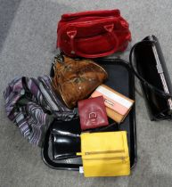 A lot comprising assorted ladies evening bags & leather purses etc Condition Report: Not available