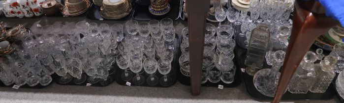 A lot comprising a large selection of cut and press moulded glass, including drinking glasses,