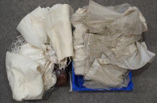 A lot comprising a cream ground embroidered shawl, a crocodile skin handbag, children's white