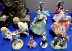 Paragon Lady Patricia, Royal Worcester See Saw, three Doulton figures including Delphine, Fair