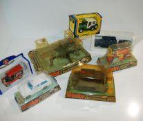 A box of various models including Dinky Static Gun, Bren Gun Carrier, Diesel Road Roller, Range