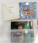 A box of rock and pop vinyl LP albums featuring The Rolling Stones, The Beatles, Slade, Jeff Beck,