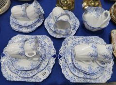 A Shelley teaset decorated with blue daisies and trailing foliage, pattern number 051/28, comprising