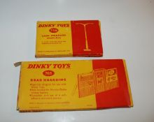 A Dinky Toys 765 Road Hoarding, 756 Lamp Standard and a box of various replica Dinky models