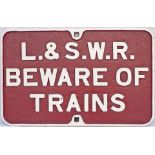 London & South Western Railway cast iron sign L&SWR BEWARE OF TRAINS. In restored condition with