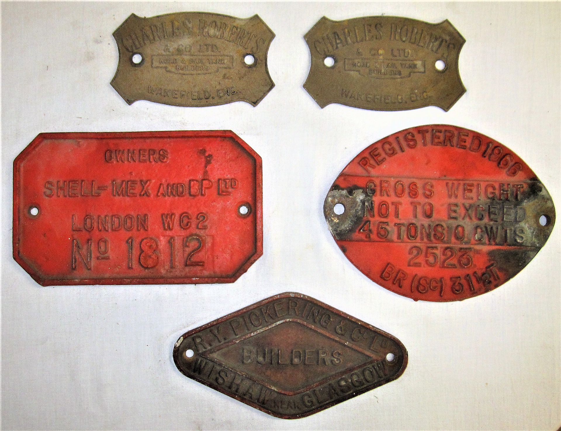 A collection of 5 x Wagon Plates. OWNERS SHELL-MEX No 1812. RV PICKERING CO LTD WISHAW & GLASCOW.