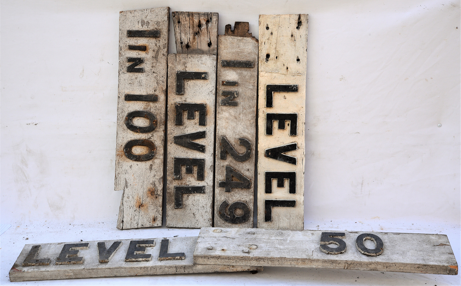 3 x wooden gradient sign tops. LEVEL - 50. LEVEL 1 in 100 and LEVEL 1 in 249. Mostly compete but