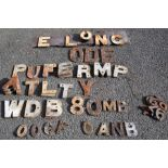 A collection of cast iron notice letters and numbers mostly 7.5 in tall with many duplicate