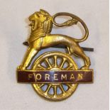 BR(W) Lion over Wheel FOREMAN Cap Badge complete with rear securing pin. Excellent original