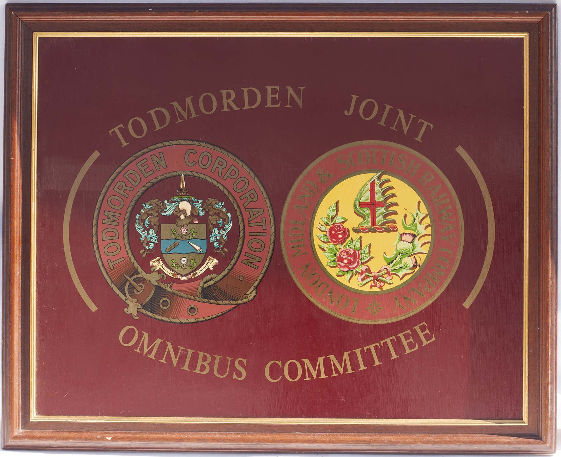 TODMORDEN JOINT OMNIBUS COMMITTEE twin mounted coat of arms. Nicely framed. Measures 31in x 25.5
