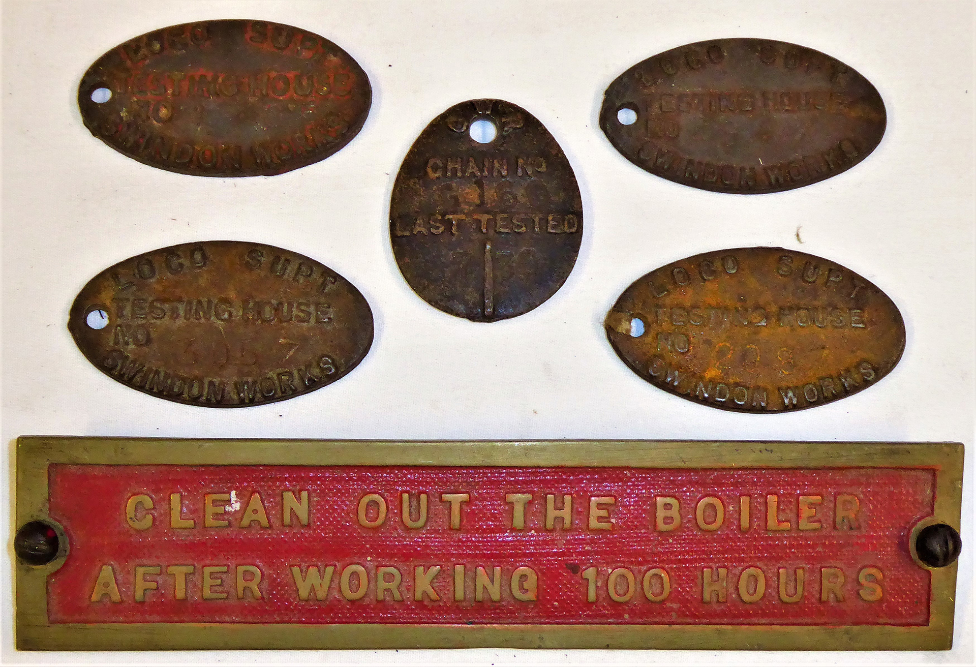 5 x cast iron SWINDON WORKS boiler testing labels together with a traction engine boiler plate,