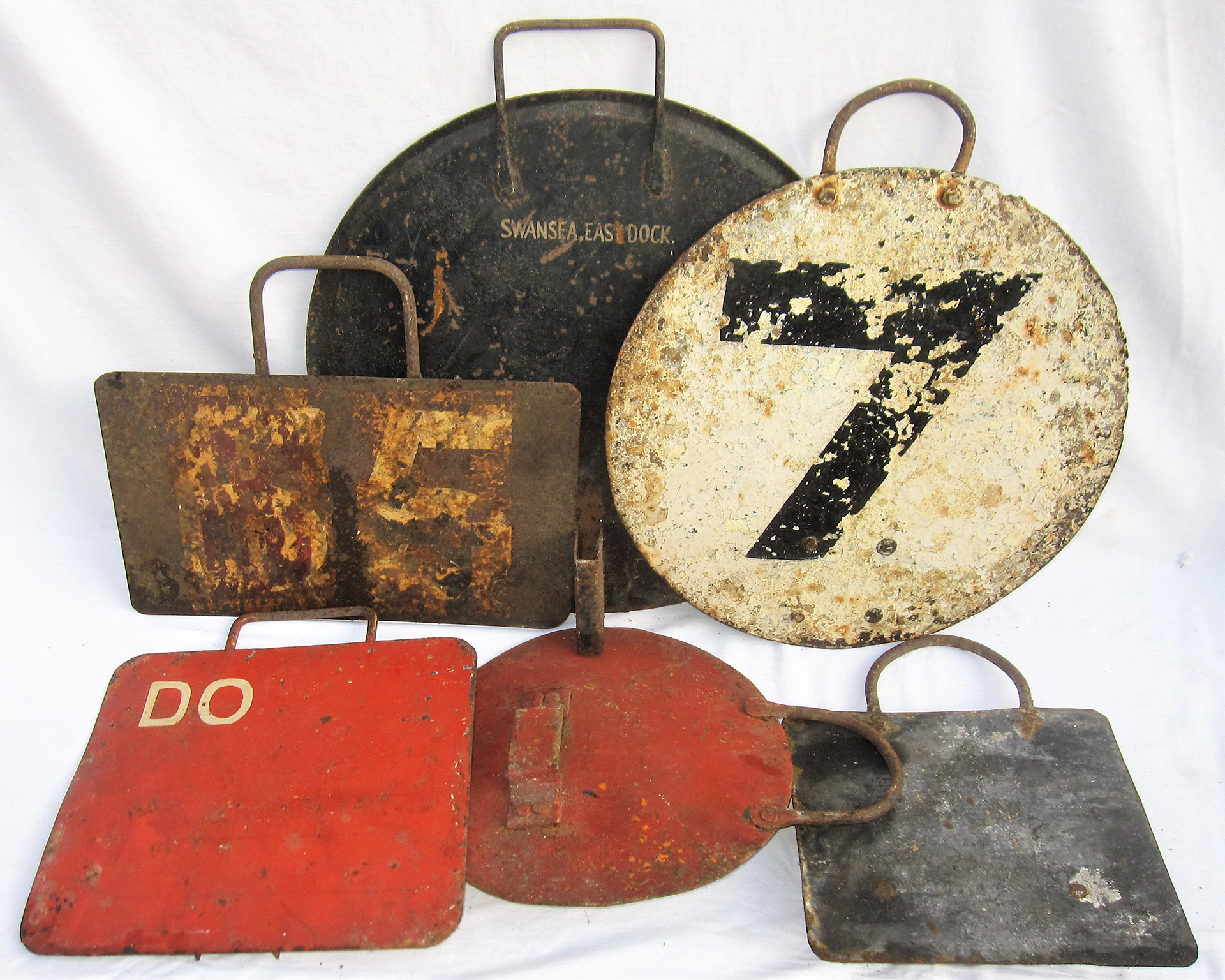 A lot containing a collection of Locomotive head discs. One disc is painted SWANSEA EAST DOCK. All