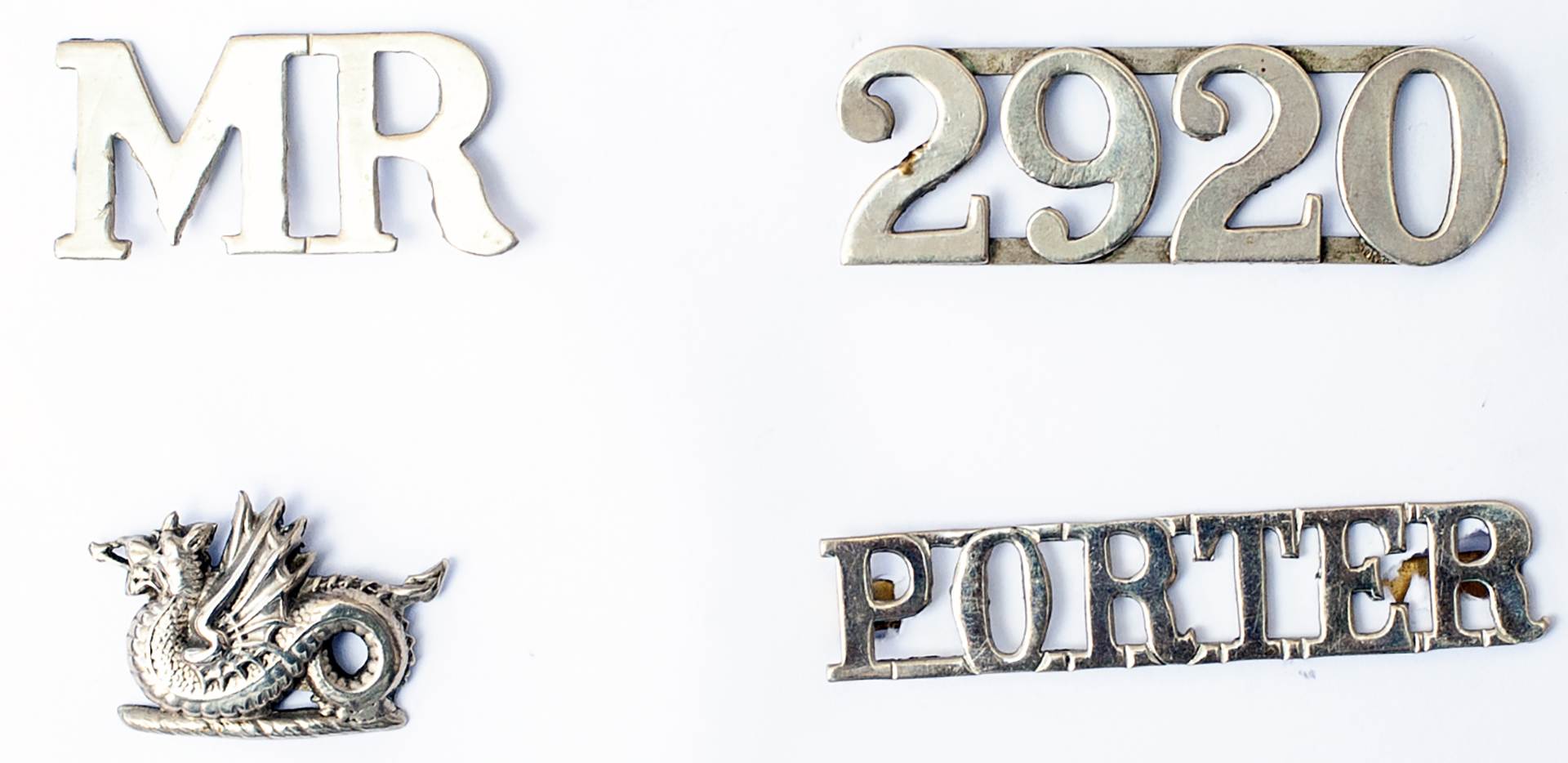 A Lot containing 4 x Railway Badges. MR. 2920. PORTER and MRCo Wyvern. All good condition.