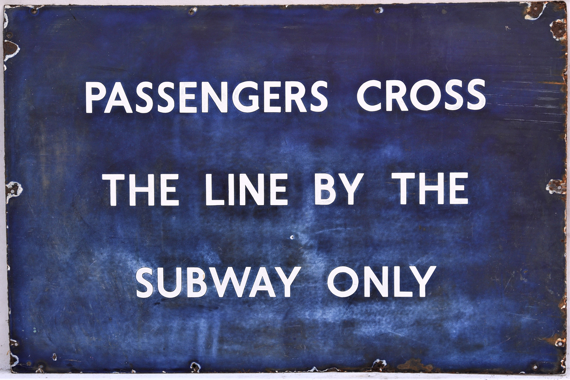 LNER/BR(E) enamel sign. PASSENGERS CROSS THE LINE BY THE SUBWAY ONLY. Measures 36in x 18in.