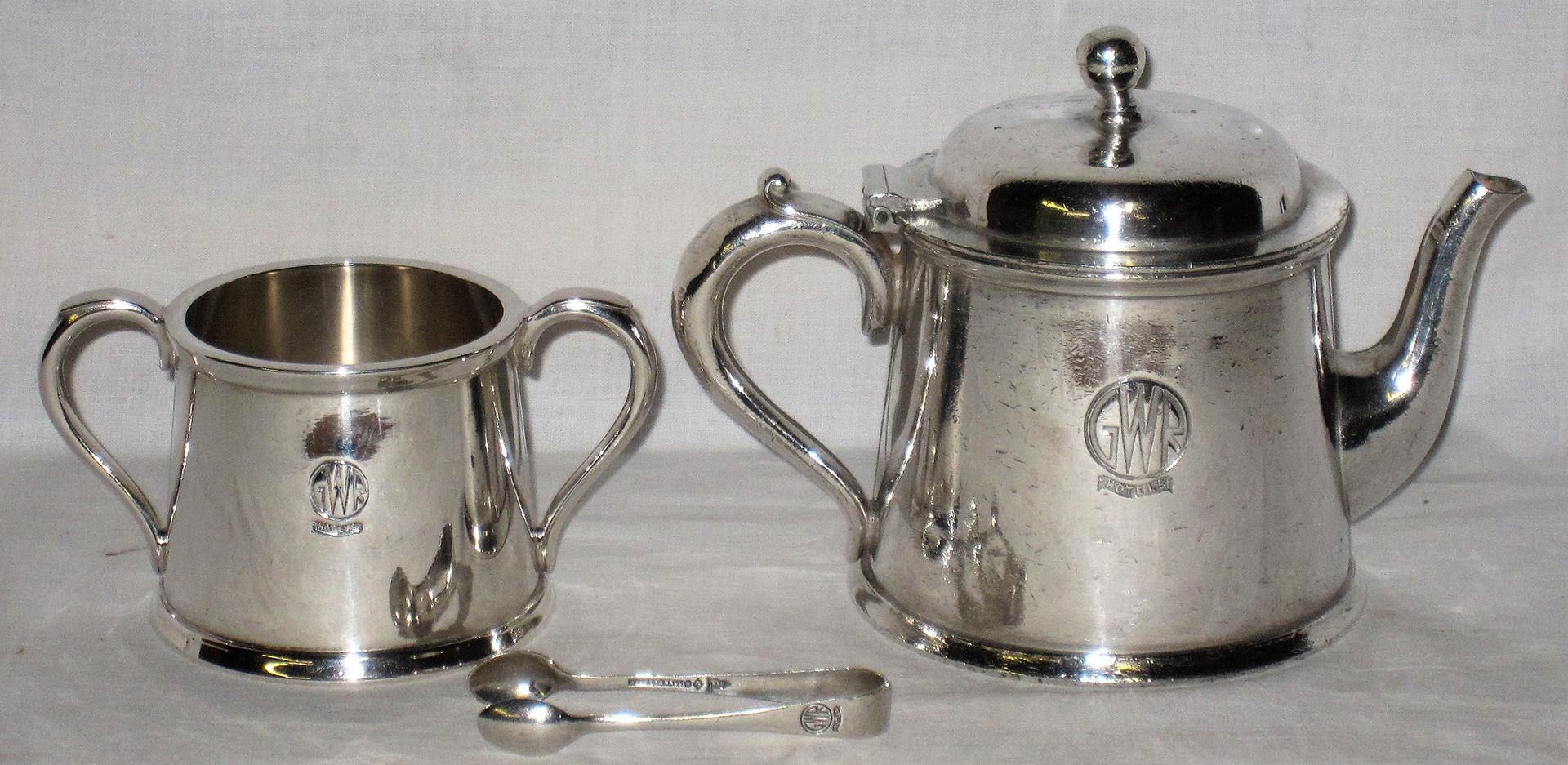 3 x pieces of GWR table silverware. GWR Tea Pot. GWR sugar bowl and a GWR Sugar tongs all in