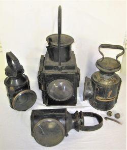 4 x Railway lamps to include BR(W) brake van lamp minus vessel. BR(M) Handlamp. BR Handlamp. LNER GE