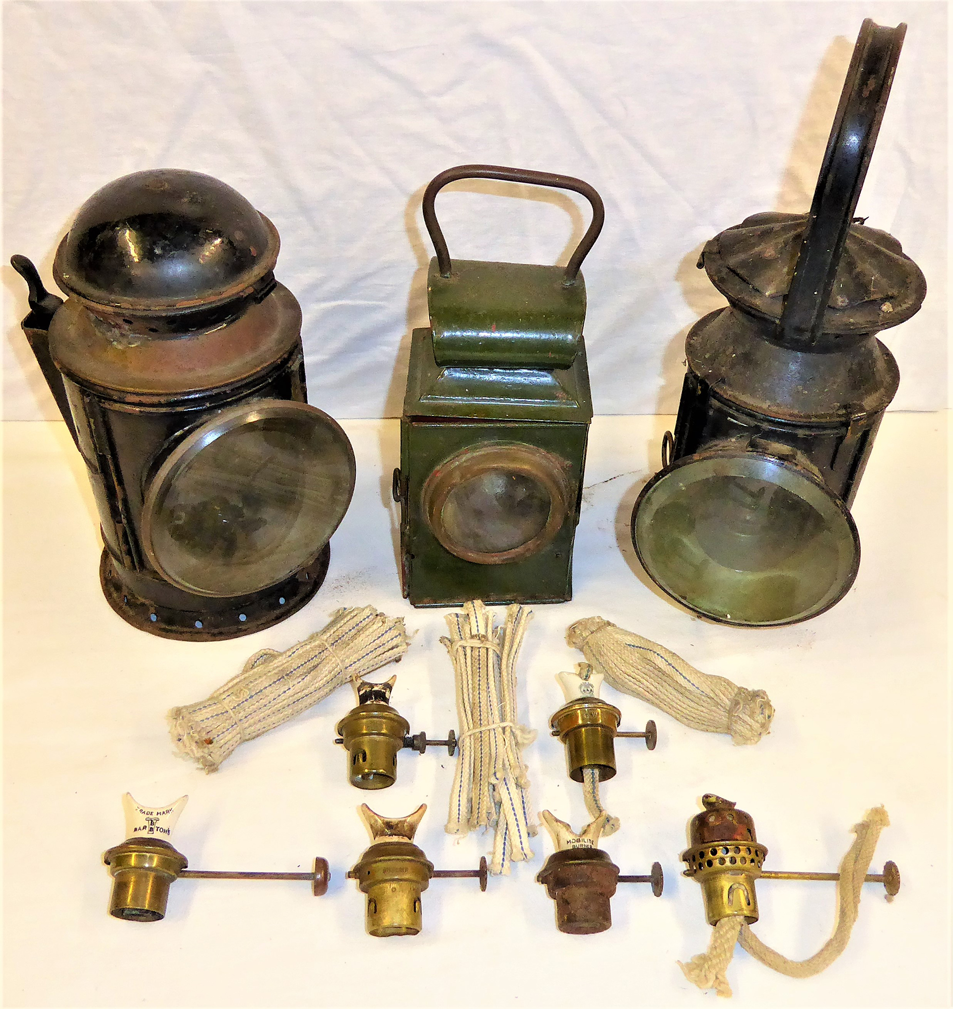 A collection of lamp spares to include hand lamp and signal lamp burners, wicks, together with 3 x