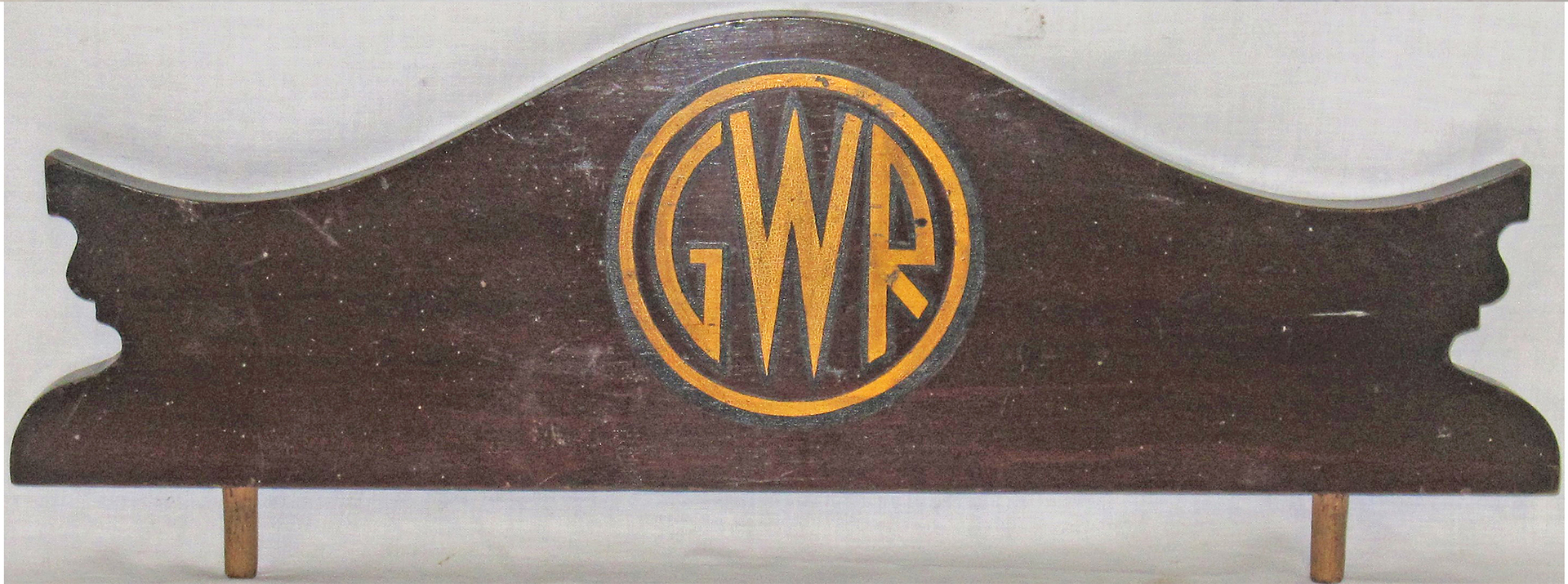 GWR wooden sign fitted with pins for mounting on a cabinet with original GWR 1935 monogram