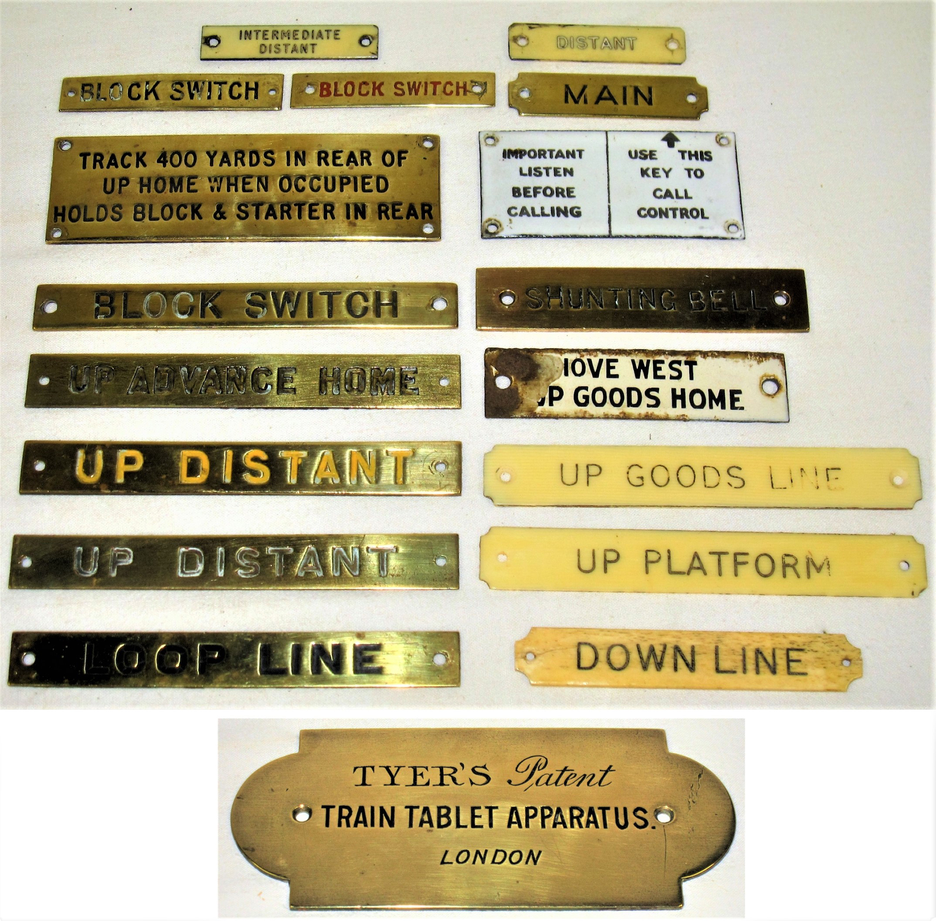 A lot containing a collection of both brass and ivorine signal box shelf plates together with a