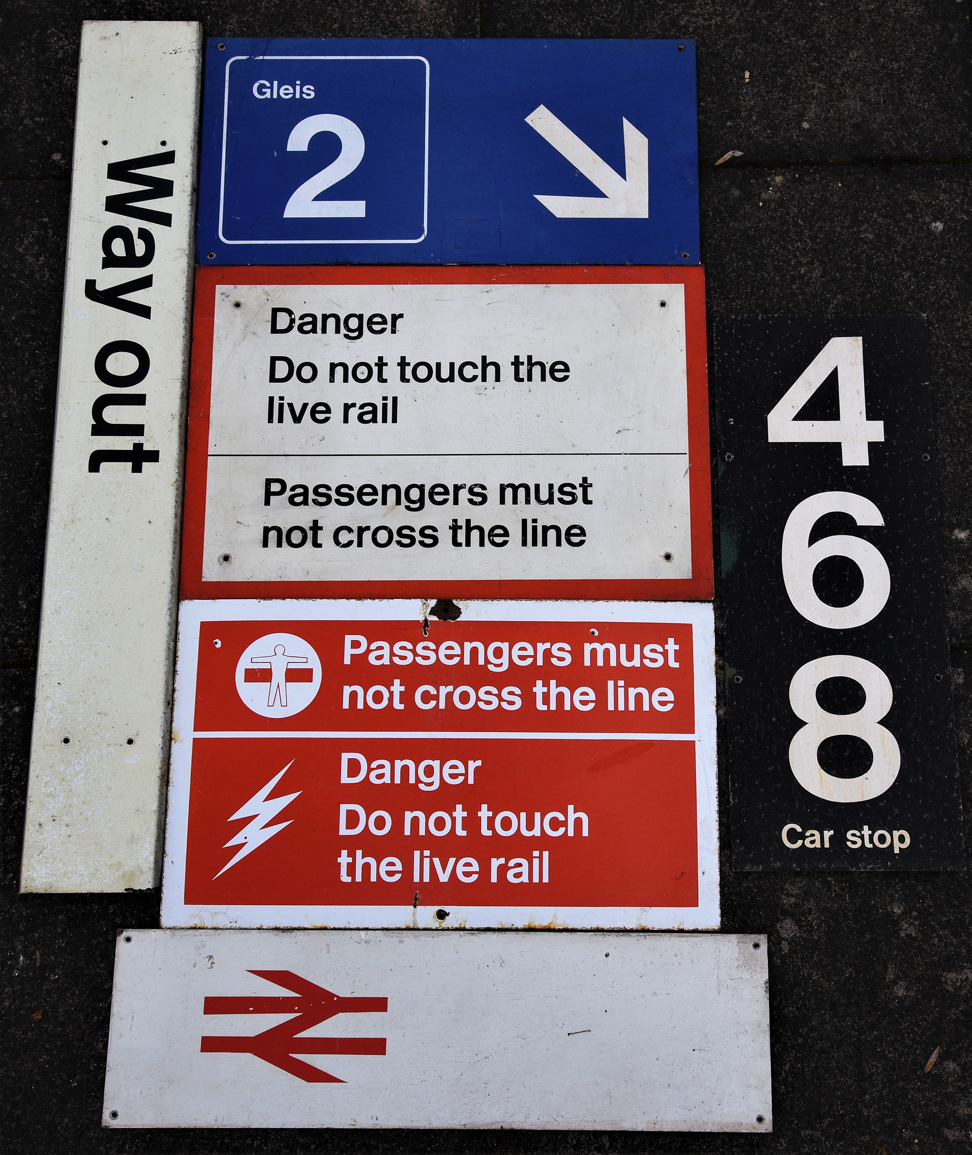 A collection of 6 x modern image signs to include WAY OUT. BR Arrow. DANGER DO NOT TOUCH LIVE RAIL