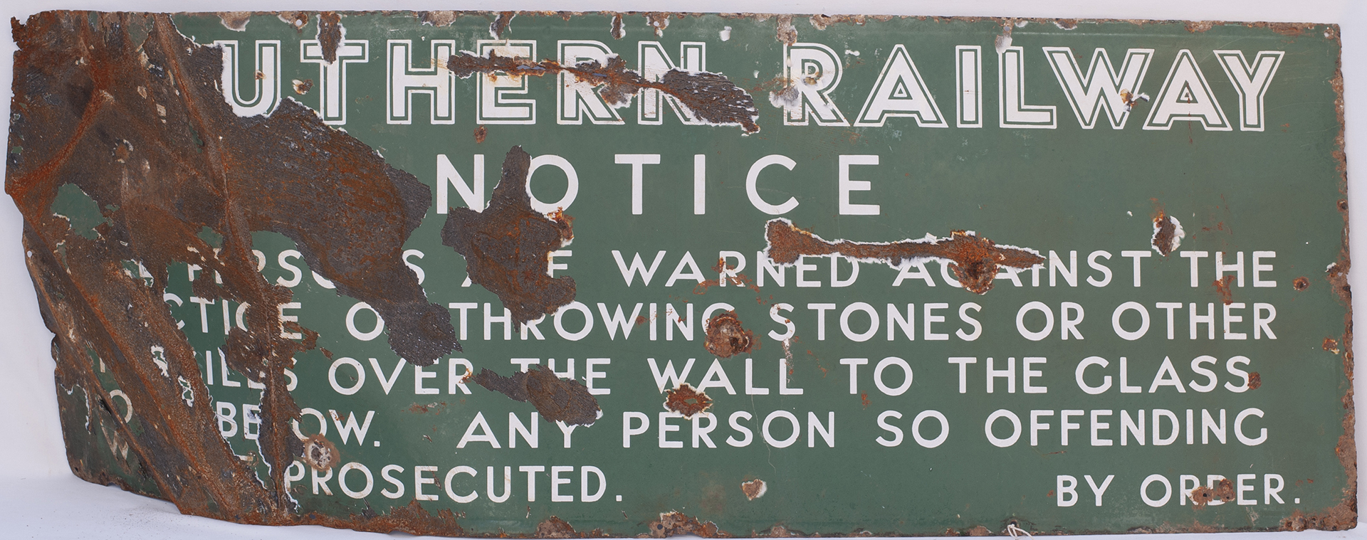 Southern Railway Enamel Sign. Ref Throwing stones over the wall etc. Recovered from Brighton Station