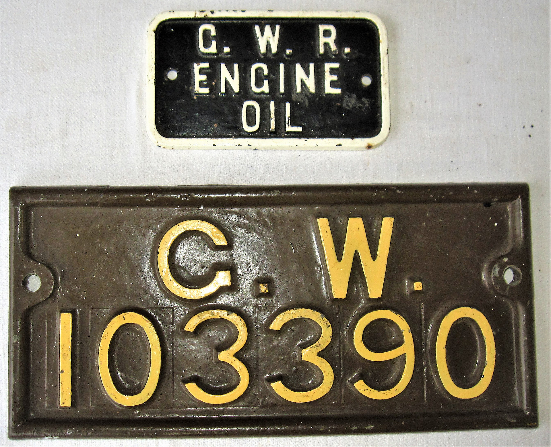 2 GWR cast iron plates. Wagon Plate G.W. 103390 together with GWR stores plate GWR ENGINE OIL.