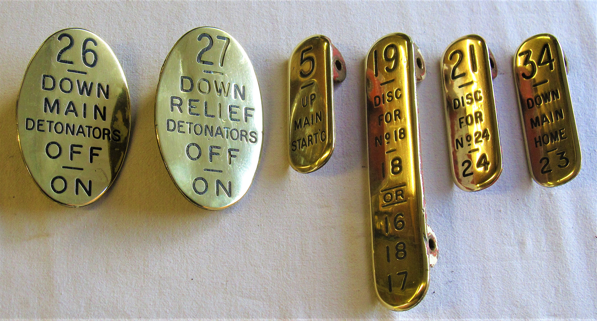 A lot containing a collection of GWR brass lever leads to include oval 26 DOWN MAIN DETONATORS. Oval