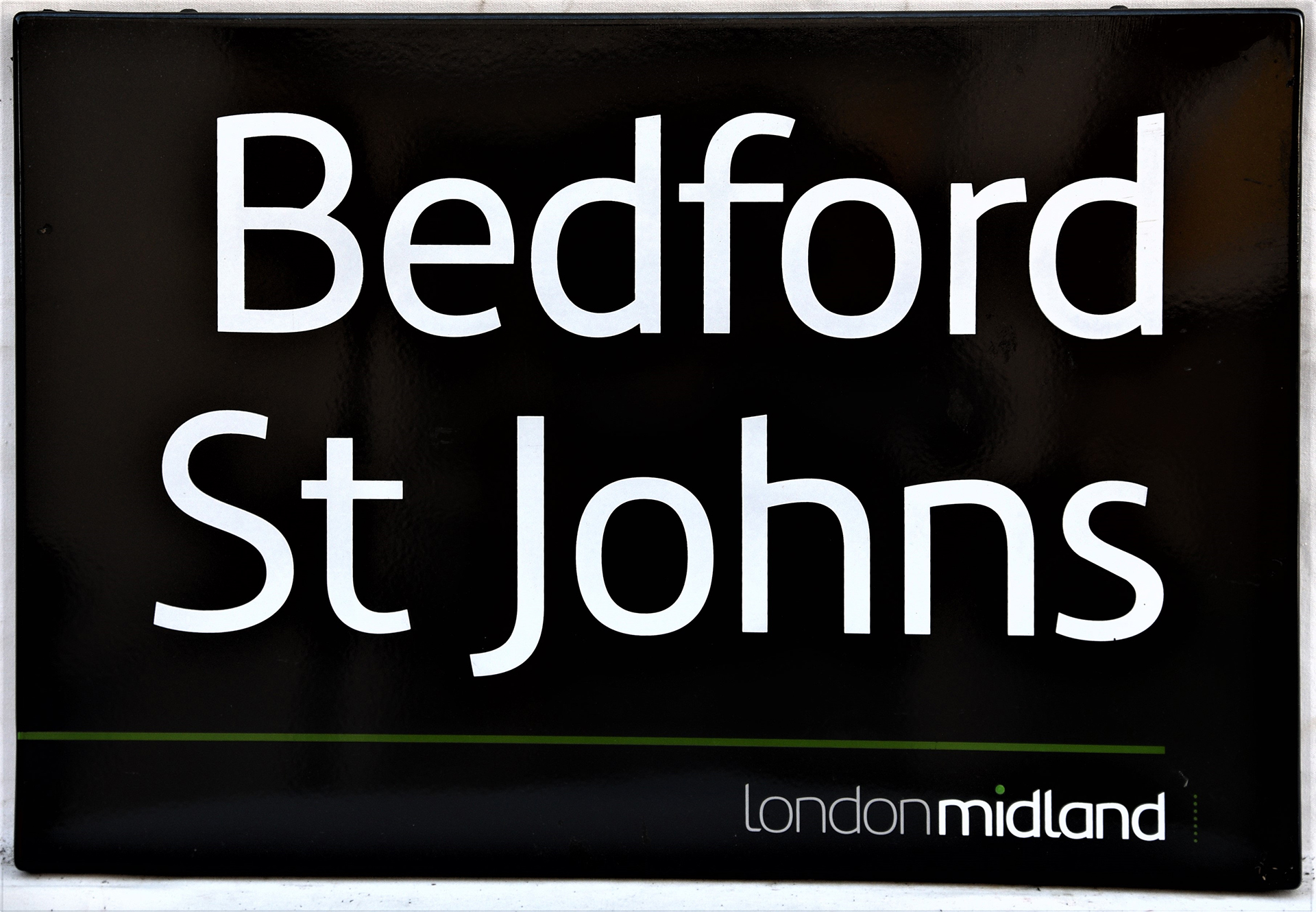 London Midland fully flanged black & white station sign. BEDFORD ST JOHNS. In excellent condition