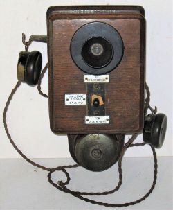 LSWR Signal Box Telephone complete with both ear pieces and fitted with enamel call plates .