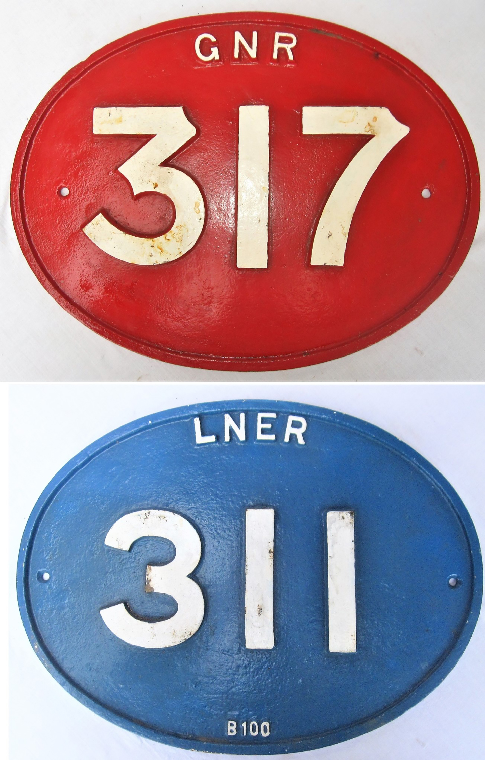 2 x cast iron bridge plates. LNER 311 together with GNR 317. Both repainted.