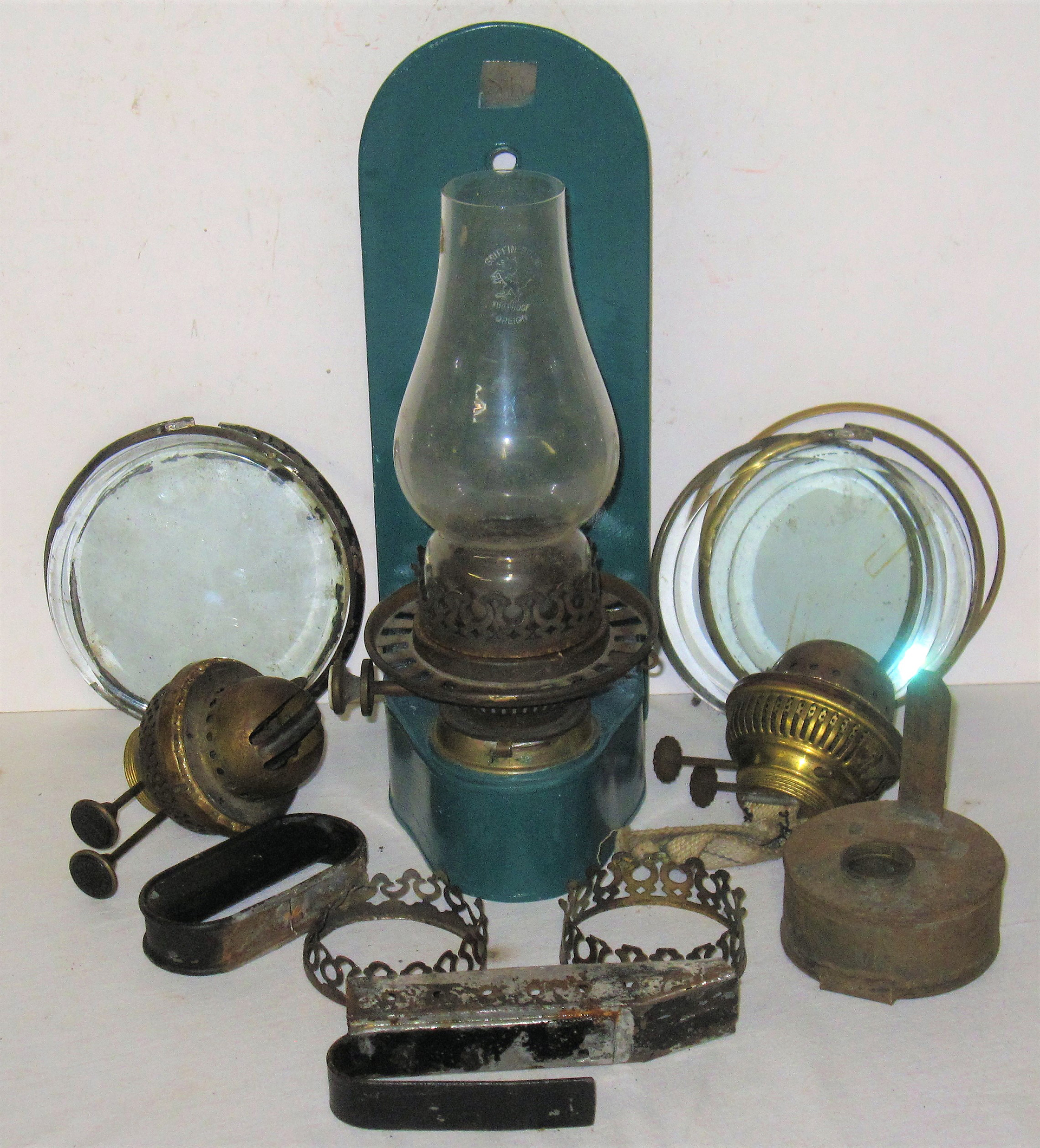 A collection of Lamp Spares to include a stamped SR wall lamp complete with twin burner and glass