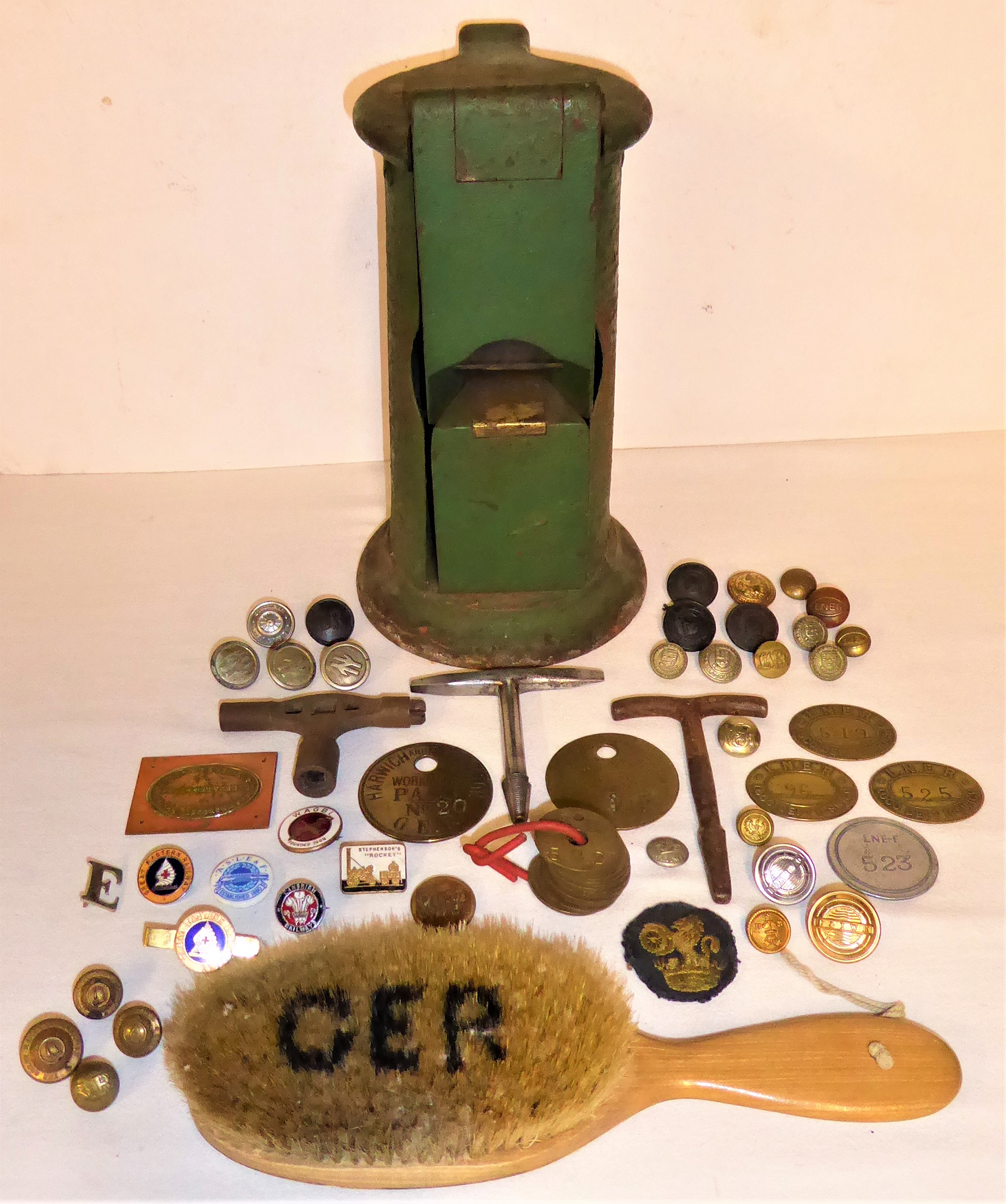 A lot containing a small collection of railway buttons, pay checks and other items including an