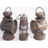 A pair of LUCUS KING OF THE ROAD Vehicle oil lamps together with a miners safety lamp.