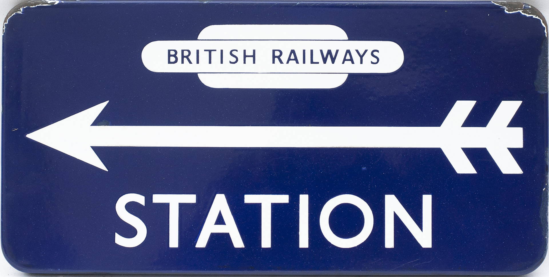 BR(E) FF enamel direction sign STATION with British Railways totem at the top and left facing arrow.