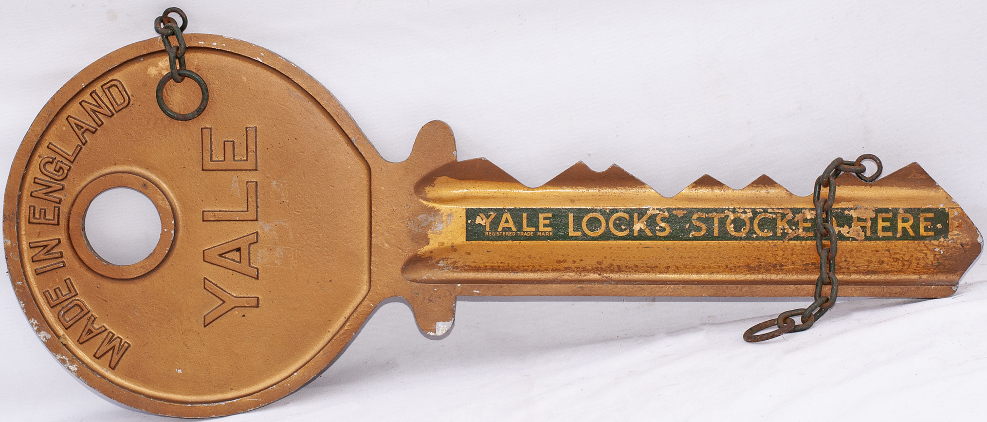 Advertising display sign in the shape of a large yale key with YALE KEYS STOCKED HERE . Cast