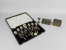 A cased set of silver spoons and forks