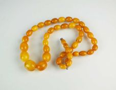 A graduated amber bead necklace,