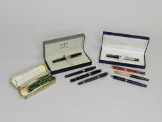 A collection of eight fountain pens