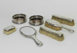 A matched collection of four silver mounted dressing tablewares