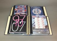 Four albums containing BC sheets, Smilers and Mint stamps