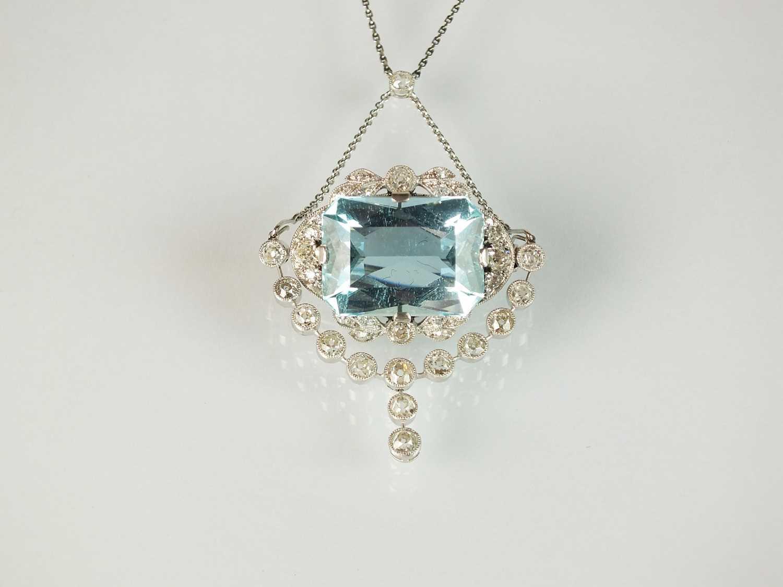A Belle Epoque aquamarine and diamond pendant/brooch